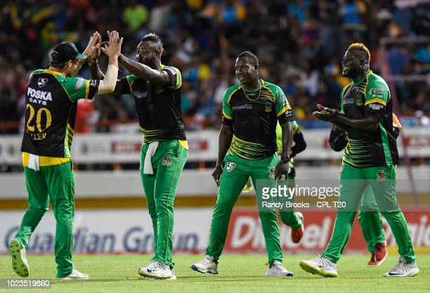 In this handout image provided by CPL T20 David Miller Andre Russell Rovman Powell and Kennar Lewis of Jamaica Tallawahs during match 17 of the Hero...