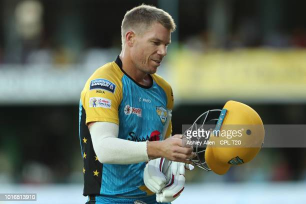 In this handout image provided by CPL T20 David Warner of St Lucia Stars is dismissed during the Hero Caribbean Premier League match between Jamaica...