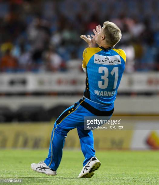 In this handout image provided by CPL T20 David Warner of St Lucia Stars takes the catch to dismiss Luke Ronchi of Guyana Amazon Warriors during...