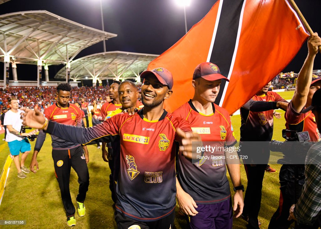 In this handout image provided by CPL T20, Denesh Ramdin (L) and Colin Munro (R) of Trinbago Knight Riders celebrate winning the Finals of the 2017 Hero Caribbean Premier League between Trinbago Knight Riders and St Kitts & Nevis Patriots at Brian Lara Cricket Academy on September 09, 2017 in Tarouba, Trinidad.
