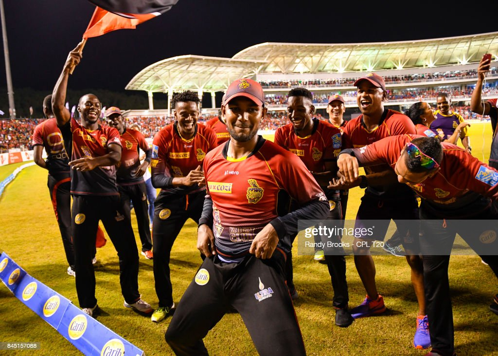 In this handout image provided by CPL T20, Denesh Ramdin (C) of Trinbago Knight Riders celebrate winning the Finals of the 2017 Hero Caribbean Premier League between Trinbago Knight Riders and St Kitts & Nevis Patriots at Brian Lara Cricket Academy on September 09, 2017 in Tarouba, Trinidad.