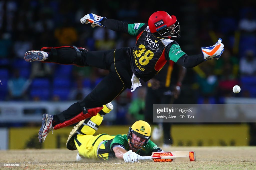 In this handout image provided by CPL T20, Devon Thomas of St Kitts and Nevis Patriots is airborne as he attempts to gather for a run out attempt on Glenn Phillips of the Jamaica Tallawahs during Match 20 of the 2017 Hero Caribbean Premier League between St Kitts and Nevis v Jamaica Tallawahs at Warner Park on August 21, 2017 in Basseterre, St Kitts.