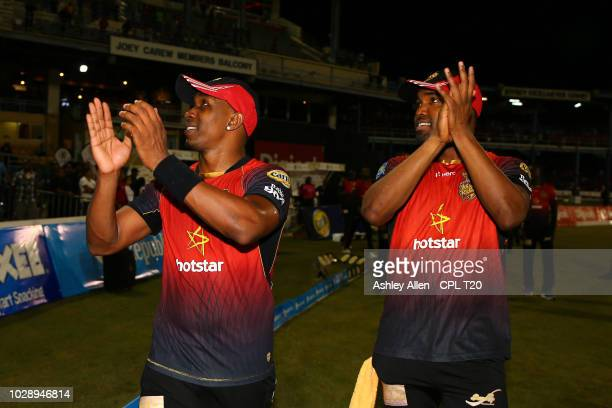 In this handout image provided by CPL T20 Dwayne Bravo and brother Darren Bravo of Trinbago Knight Riders lead the team on a lap of honour during the...