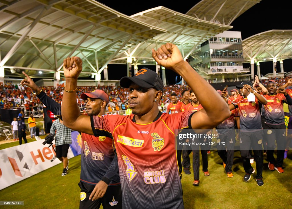 In this handout image provided by CPL T20, Dwayne Bravo (R) and Denesh Ramdin (L) of Trinbago Knight Riders celebrate winning the Finals of the 2017 Hero Caribbean Premier League between Trinbago Knight Riders and St Kitts & Nevis Patriots at Brian Lara Cricket Academy on September 09, 2017 in Tarouba, Trinidad.