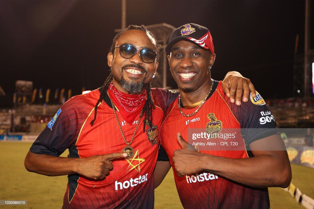In this handout image provided by CPL T20, Dwayne Bravo of Trinbago Knight Riders and Soca Singer Machel Montano during the Hero Caribbean Premier League Semi-Final match between Trinbago Knight Riders and St Kitts and Nevis Patriots at Brian Lara Stadium on September 14, 2018 in Tarouba, Trinidad and Tobago.