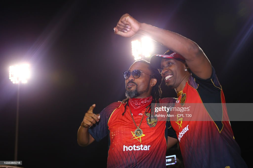 In this handout image provided by CPL T20, Dwayne Bravo (R) of Trinbago Knight Riders and Soca Singer Machel Montano (L) celebrate after the Hero Caribbean Premier League Semi-Final match between Trinbago Knight Riders and St Kitts and Nevis Patriots at Brian Lara Stadium on September 14, 2018 in Tarouba, Trinidad and Tobago.