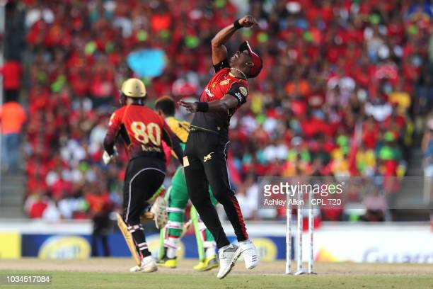 In this handout image provided by CPL T20 Dwayne Bravo of Trinbago Knight Riders celebrates catching Shimron Hetmyer of Guyana Amazon Warriors during...