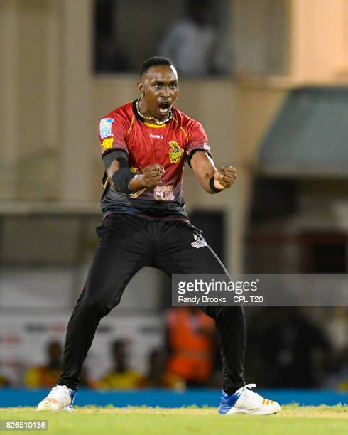 In this handout image provided by CPL T20 Dwayne Bravo of Trinbago Knight Riders celebrates the dismissal of Rahkeem Cornwall of St Lucia Stars...