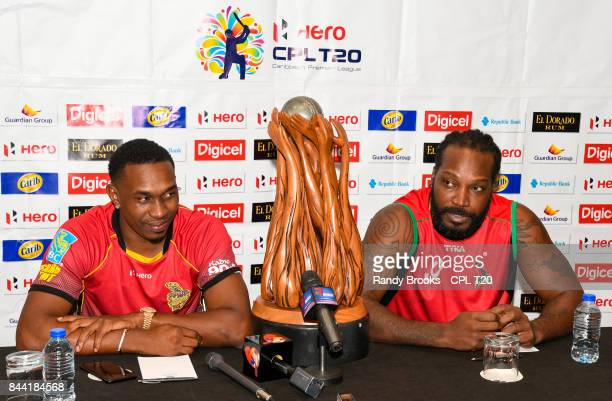 In this handout image provided by CPL T20 Dwayne Bravo of Trinbago Knight Riders and Chris Gayle of St Kitts Nevis Patriots during a press conference...