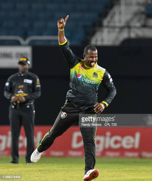 In this handout image provided by CPL T20 Dwayne Smith of Jamaica Tallawahs celebrates the dismissal of Shimron Hetmyer of Guyana Amazon Warriors...