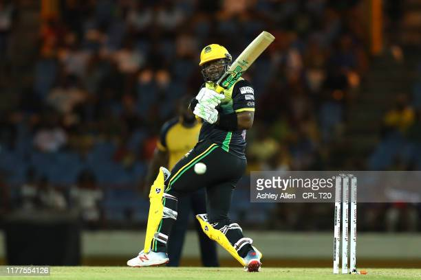 In this handout image provided by CPL T20 Dwayne Smith of Jamaica Tallawahs hits four during the Hero Caribbean Premier League match between St Lucia...
