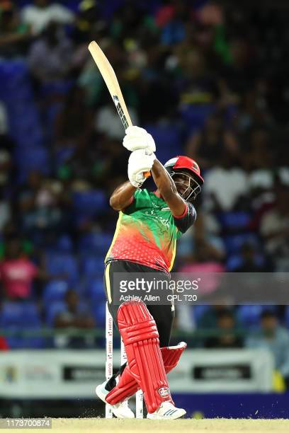 In this handout image provided by CPL T20, Evin Lewis of St Kitts and Nevis Patriots hits six during the Hero Caribbean Premier League match between...