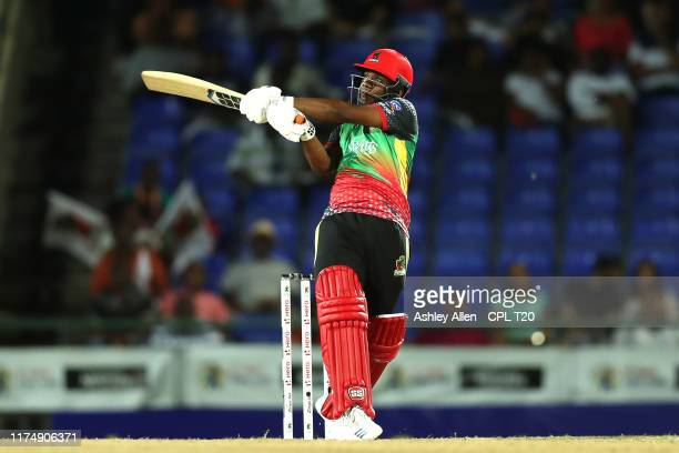 In this handout image provided by CPL T20, Evin Lewis of St Kitts and Nevis Patriots hits a six during the Hero Caribbean Premier League match...