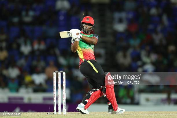 In this handout image provided by CPL T20, Evin Lewis of St Kitts and Nevis Patriots hits six runs during the Hero Caribbean Premier League match...