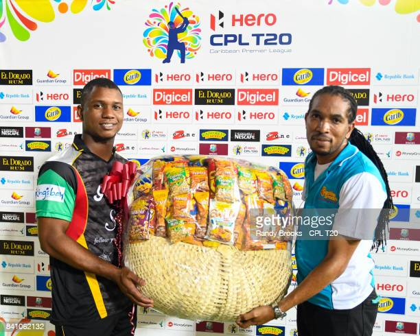 In this handout image provided by CPL T20 Evin Lewis of St Kitts Nevis Patriots receives the power shot prize at the end of Match 26 of the 2017 Hero...