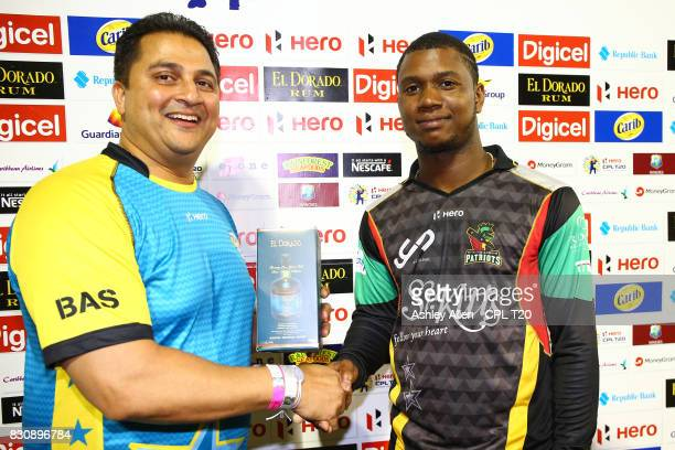 In this handout image provided by CPL T20, Evin Lewis of the St Kitts and Nevis Patriots receives his Man of the Match award during Match 10 of the...