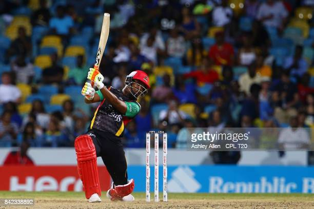 In this handout image provided by CPL T20, Evin Lewis of the St Kitts and Nevis Patriots plays an attacking shot through the offside en route to 97...