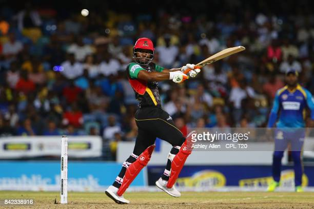 In this handout image provided by CPL T20 Evin Lewis of the St Kitts and Nevis Patriots pulls the ball for four during Match 30 of the 2017 Hero...