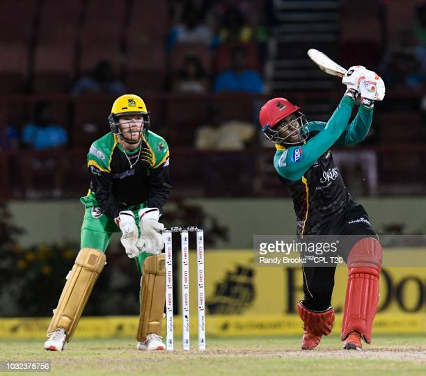 In this handout image provided by CPL T20, Fabian Allen hits 6 and Glenn Phillips of St Kitts & Nevis Patriots of Jamaica Tallawahs watch during the...