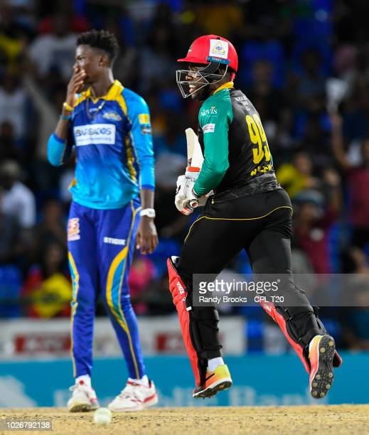 In this handout image provided by CPL T20, Fabian Allen of St Kitts & Nevis Patriots get the last runs off Domnic Drakes of Barbados Tridents during...