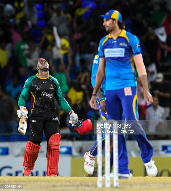 In this handout image provided by CPL T20, Fabian Allen of St Kitts & Nevis Patriots celebrates the victory as Mohammad Irfan of Barbados Tridents...