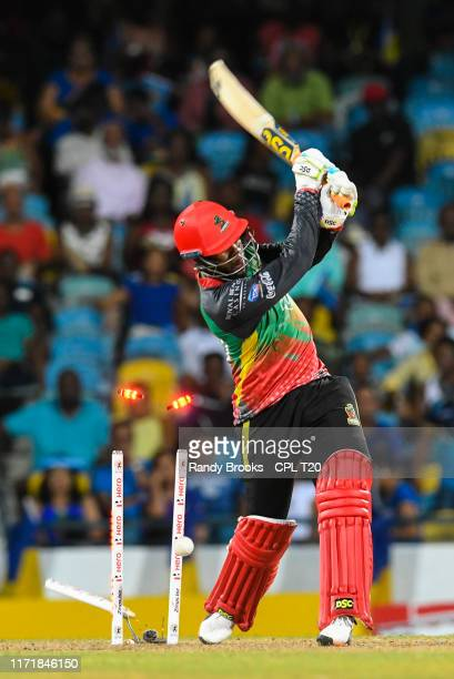 In this handout image provided by CPL T20, Fabian Allen of St Kitts Nevis and Patriots bowled by Harry Gurney of Barbados Tridents during match 25 of...