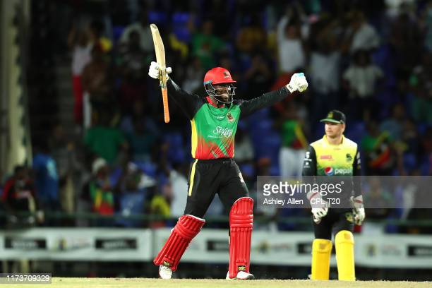 In this handout image provided by CPL T20, Fabian Allen of St Kitts and Nevis Patriots celebrates hitting the winning runs during the Hero Caribbean...
