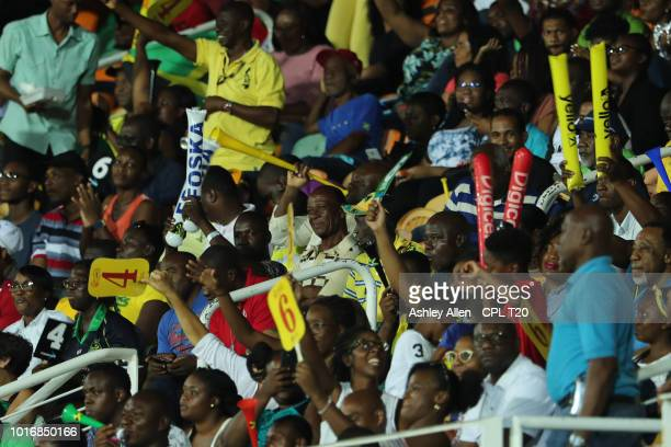 In this handout image provided by CPL T20 Fans look on during the Hero Caribbean Premier League match between Jamaica Tallawahs and St Lucia Stars at...