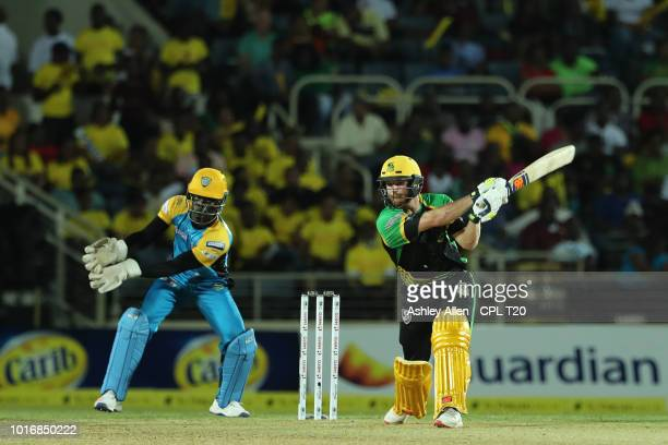 In this handout image provided by CPL T20 Glenn Phillips of Jamaica Tallawahs bats as Andre Fletcher of St Lucia Stars looks on during the Hero...