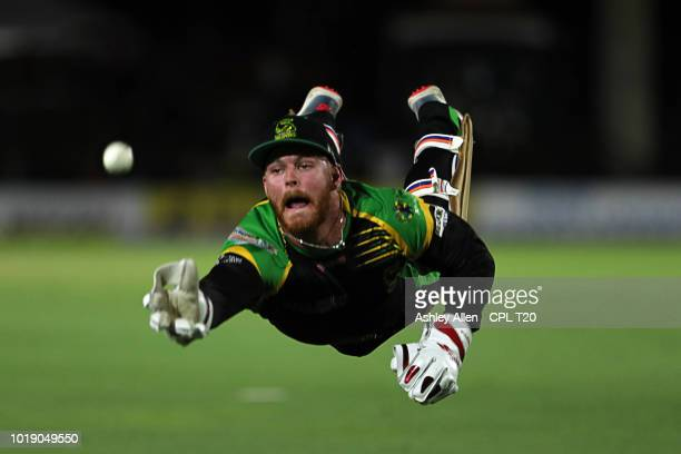 In this handout image provided by CPL T20 Glenn Phillips of Jamaica Tallwahs attempts to catch Shimron Hetmyer of Guyana Amazon Warriors during the...