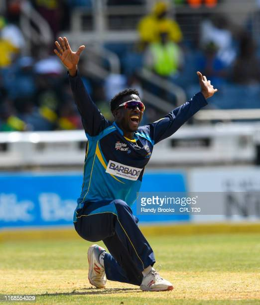 In this handout image provided by CPL T20 Hayden Walsh Jr of Barbados Tridents appeals for lbw against George Worker of Jamaica Tallawahs during...