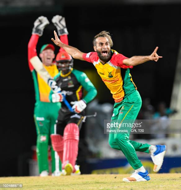 In this handout image provided by CPL T20 Imran Tahir of Guyana Amazon Warriors appeals for ruling against Devon Thomas of St Kitts Nevis Patriots...
