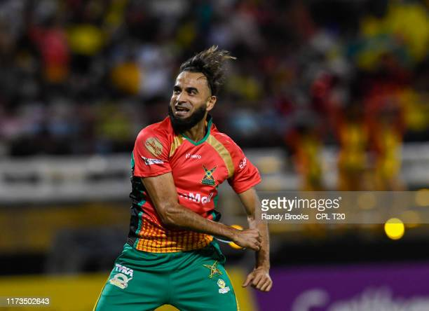 In this handout image provided by CPL T20 Imran Tahir of Guyana Amazon Warriors celebrate the dismissal of Chadwick Walton of Jamaica Tallawahs...