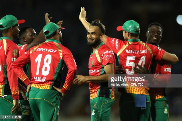 In this handout image provided by CPL T20 Imran Tahir of Guyana Amazon Warriors celebrates with teammates during the Hero Caribbean Premier League...