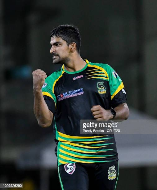 In this handout image provided by CPL T20 Ish Sodhi of Jamaica Tallawahs celebrates the dismissal of Shimron Hetmyer of Guyana Amazon Warriors during...