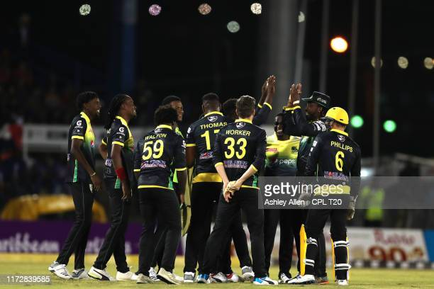 In this handout image provided by CPL T20 Jamaica Tallawahs celebrate during the Hero Caribbean Premier League match between Trinbago Knight Riders...