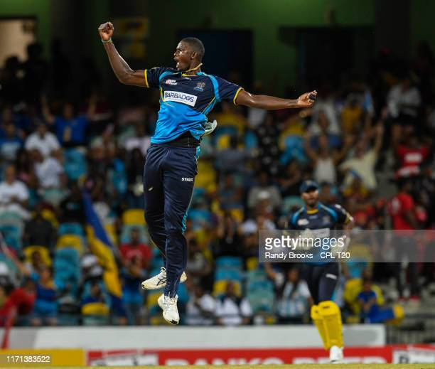 In this handout image provided by CPL T20, Jason Holder of Barbados Tridents celebrates the dismissal of Sunil Narine of Trinbago Knight Riders...