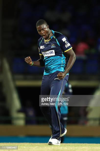 In this handout image provided by CPL T20 Jason Holder of Barbados Tridents celebrates picking up the wicket of Devon Thomas of St Kitts and Nevis...