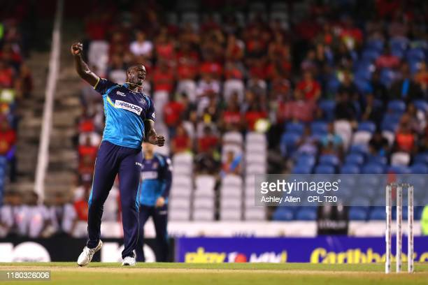 In this handout image provided by CPL T20, Jason Holder of Barbados Tridents celebrates picking up the wicket of Lendl Simmons of Trinbago Knight...