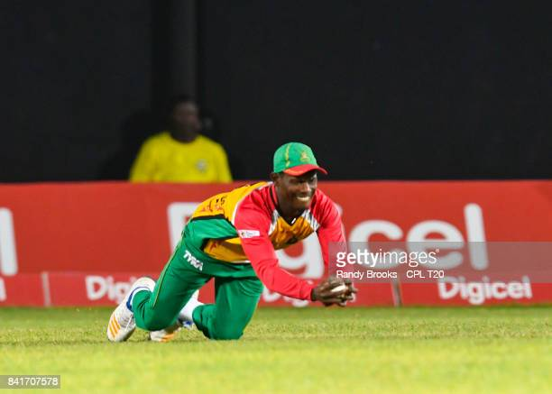 In this handout image provided by CPL T20 Jason Mohammed of Guyana Amazon Warriors takes the catch to dismiss Kumar Sangakkara of Jamaica Tallawahs...