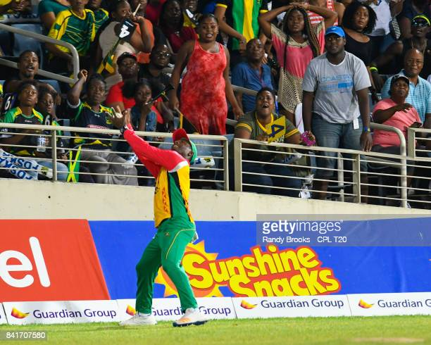 In this handout image provided by CPL T20 Jason Mohammed of Guyana Amazon Warriors takes the catch to dismiss Mahmuddulah Riyad of Jamaica Tallawahs...