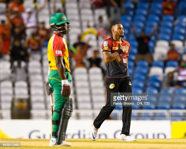 In this handout image provided by CPL T20 Javon Searles of Trinbago Knight Riders celebrates the dismissal of Jason Mohammed of Guyana Amazon...