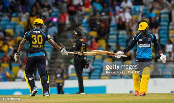 In this handout image provided by CPL T20, Johnson Charles and Jonathan Carter of Barbados Tridents 100 partnership during match 23 of the Hero...