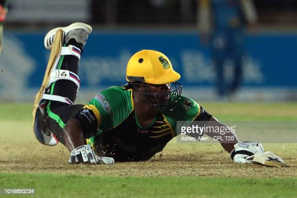 In this handout image provided by CPL T20 Johnson Charles of Jamaica Tallawahs dives in to make his ground during the Hero Caribbean Premier League...