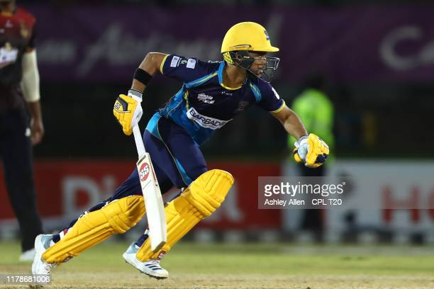 In this handout image provided by CPL T20, JP Duminy of Barbados Tridents turns for a second run to win the game during the Hero Caribbean Premier...