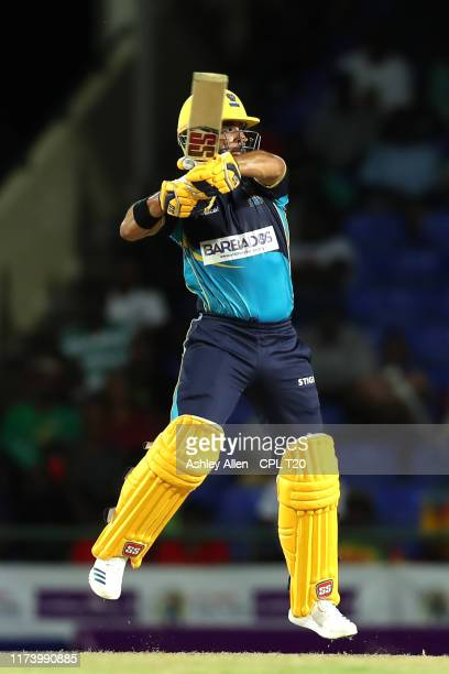 In this handout image provided by CPL T20, JP Duminy of Barbados Tridents hits a boundary during the Hero Caribbean Premier League match between St...