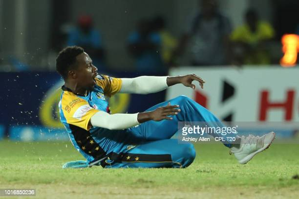 In this handout image provided by CPL T20 Kavem Hodge of St Lucia Stars celebrates the wicket of Johnson Charles during the Hero Caribbean Premier...
