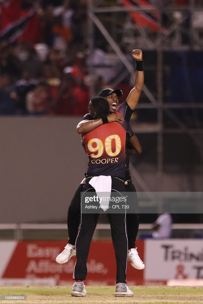 In this handout image provided by CPL T20, Kevon Cooper and Dwayne Bravo of Trinbago Knight Riders celebrate victory during the Hero Caribbean Premier League Semi-Final match between Trinbago Knight Riders and St Kitts and Nevis Patriots at Brian Lara Stadium on September 14, 2018 in Tarouba, Trinidad and Tobago.