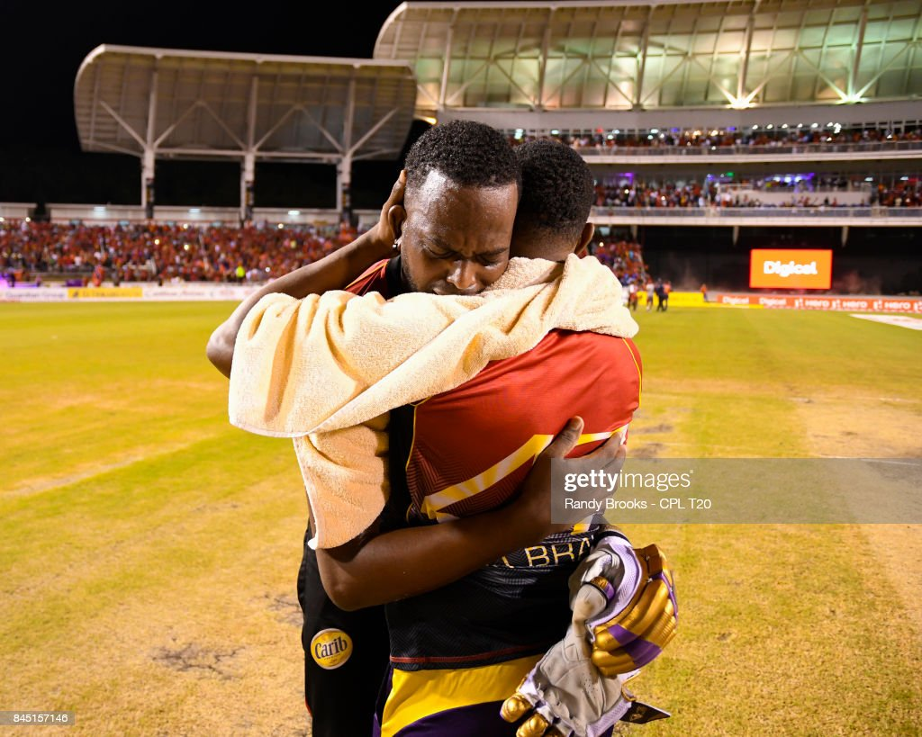 In this handout image provided by CPL T20, Kevon Cooper and Dwayne Bravo of Trinbago Knight Riders celebrate winning the Finals of the 2017 Hero Caribbean Premier League between Trinbago Knight Riders and St Kitts & Nevis Patriots at Brian Lara Cricket Academy on September 09, 2017 in Tarouba, Trinidad.