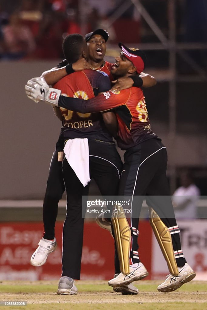 In this handout image provided by CPL T20, Kevon Cooper, Dwayne Bravo and Denesh Ramdin of Trinbago Knight Riders celebrate victory during the Hero Caribbean Premier League Semi-Final match between Trinbago Knight Riders and St Kitts and Nevis Patriots at Brian Lara Stadium on September 14, 2018 in Tarouba, Trinidad and Tobago.
